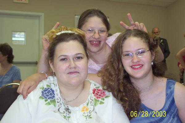10 years ago at my brother's wedding...interesting hair choices for both of us LOL...and my niece Lydia giving us bunny ears